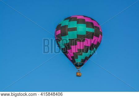 Peaceful Flight Over Sunny Arizona In A Brightly Colored Hot Air Balloon. Maricopa County, Arizona