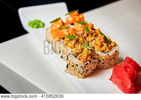 Rolls With Salmon, Mussels, Cream Cheese, Cucumber, Lettuce, Green Onions And Sesame Spice Sauce On