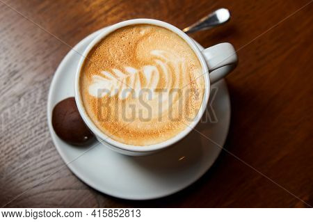 A Cup Of Coffee. Latte With A Pattern In A White Cup.