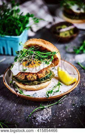 Fish Burger With Avocado Sauce. Selective Focus