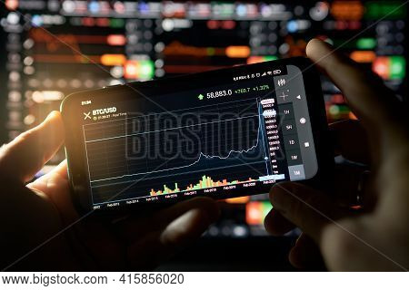 Venice, Italy - 06 April 2021: Businessman Is Checking Bitcoin Price Chart On Digital Exchange On Mo