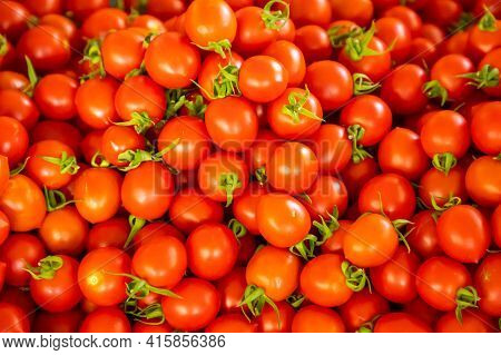 Group Of Tomatoes In Turkish Market In Antalia, Turkey. Red Fresh Tomatoes Background