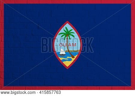 Flag Of Guam. Brick Wall Texture Of The Flag Of Guam.