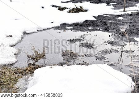 Spring Puddles And Water On The Land Of The Dacha