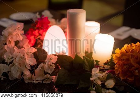 Slow Wide Angle Shot With Flowers And Candles And A Flickering Dome Light Showing The Setting For A
