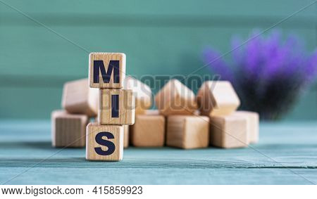 Mis (management Information System)- Acronym On Wooden Cubes On A Green Background With Lavender. Bu