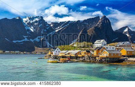 Yellow Fishing hut (rorbu) in the Hamnoy Islands - Sakrisoy (Sakrisoya) Reine, Hamnoy, Moskenes, Lofoten islands, Norway