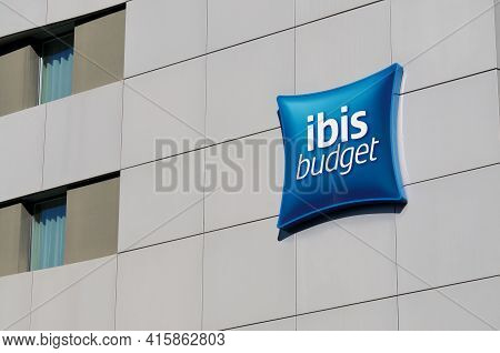 Lugano, Ticino, Switzerland - 16th March 2021 : Ibis Budget Hotels Sign Hanging On The Hotel Buildin