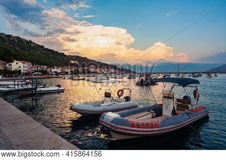 View Of Moored Boats At Sunset In The Baska Town, Krk. Croatia