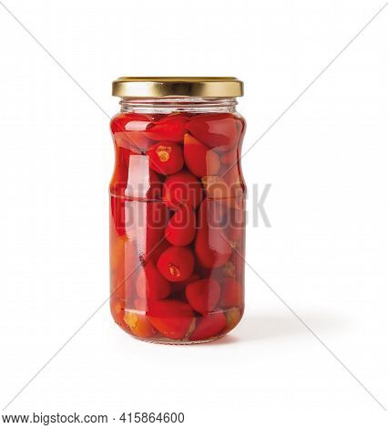 Pickled Baby Red Hot Peppers In A Glass Jar Isolated On White Background. Full Jar Of Small Hot Pepp