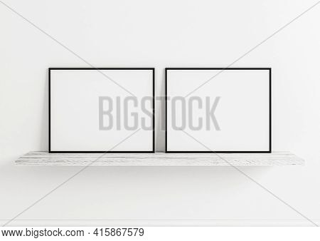 Double 8x10 Horizontal Black Frame Mockup On Wooden Shelf And White Wooden Wall. Two Empty Poster Fr