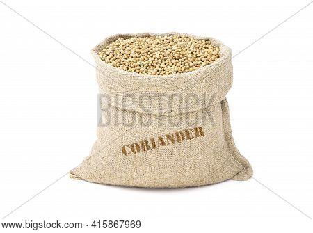 Seeds Of Coriander In A Sack Of Isolated On A White Background. Coriander In A Burlap Sack. Healthy