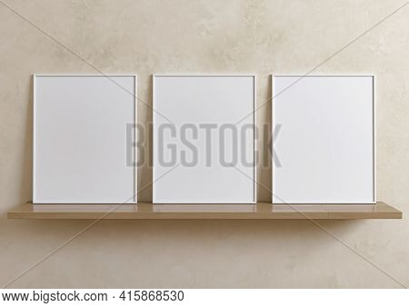 Triple 8x10 Vertical White Frame Mockup On Wooden Shelf And Beige Wall. Three Empty Poster Frame Moc