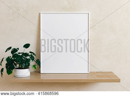 Single 8x10 Vertical White Frame Mockup With Plant In Vase On Wooden Shelf And Beige Wall. One Empty