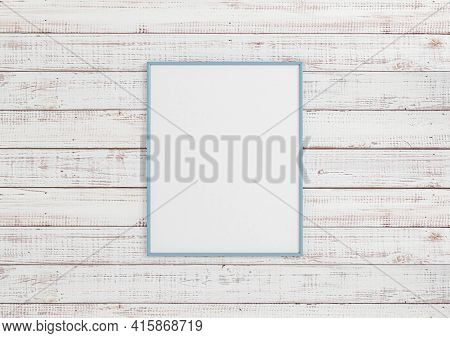 Single 8x10 Vertical Blue Frame Mockup On White Wooden Wall. One Empty Poster Frame Mockup On White