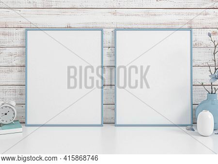 Double 8x10 Vertical Blue Frame Mockup On White Floor And White Wooden Wall. Two Empty Poster Frame