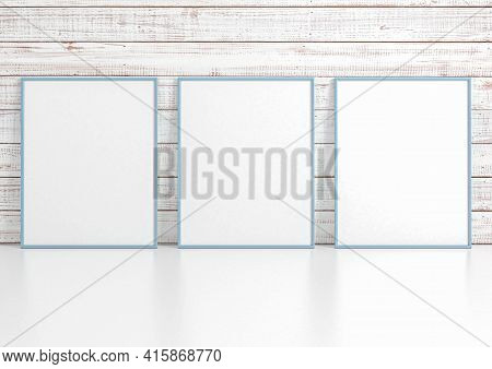 Triple 8x10 Vertical Blue Frame Mockup On White Floor And White Wooden Wall. Three Empty Poster Fram