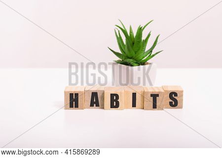 Habits Sign With The Word Habits On A Wooden Desk In A Bright Room.