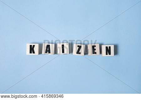 Kaizen - Words From Wooden Blocks With Letters, A Japanese Business Philosophy Kaizen Concept, White