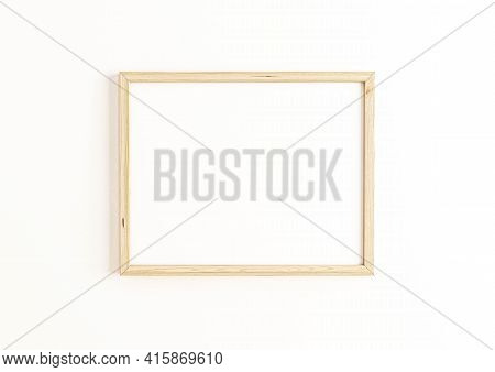 Single 8x10 Horizontal Wooden Frame Mockup On White Wall. One Empty Poster Frame Mockup On White Bac