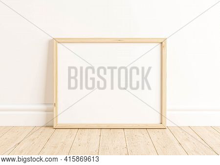 Single 8x10 Horizontal Wooden Frame Mockup On Wooden Floor And White Wall. One Empty Poster Frame Mo