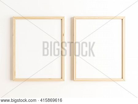 Double 8x10 Vertical Wooden Frame Mockup On White Wall. Two Empty Poster Frame Mockup On White Backg