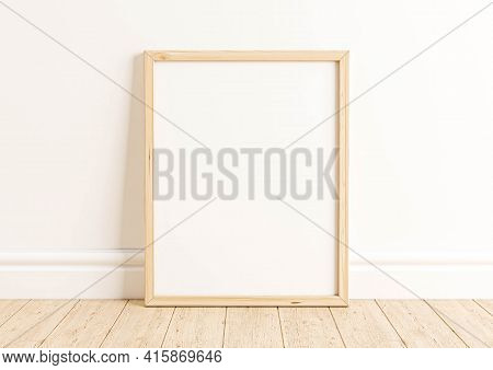 Single 8x10 Vertical Wooden Frame Mockup On Wooden Floor And White Wall. One Empty Poster Frame Mock