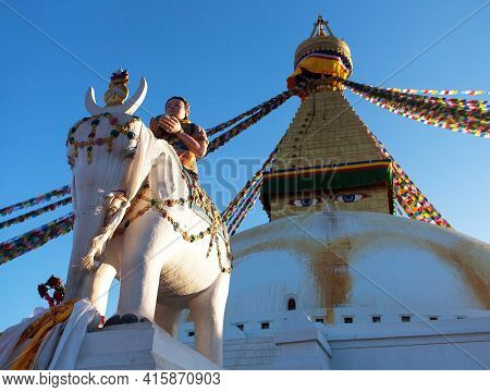 Boudha, Bodhnath Or Boudhanath Stupa With Prayer Flags And Statue Of Elephant With People, The Bigge