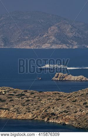 Ios, Greece - July 31, 2019 : Panoramic View Of A Ferry Boat Approaching The Island Of Ios Cyclades
