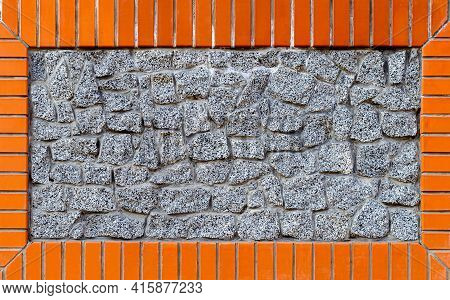 Wall With Masonry Of Granite And Orange Tiles, Granite In The Frame