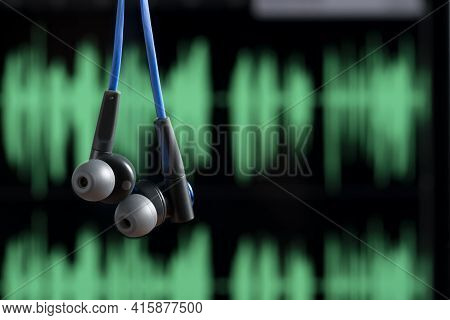 Headphone Hanging With Sound Waves On Blurred Background