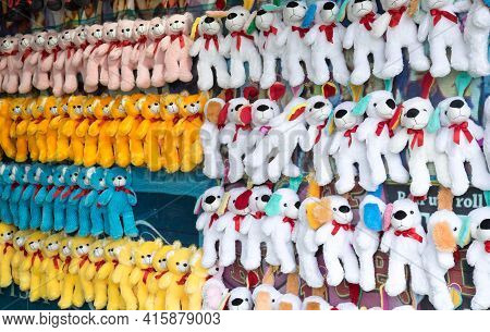 Plush Toys And Teddy Bears Hanging Up As Prizes At A Carnival Or Fairground
