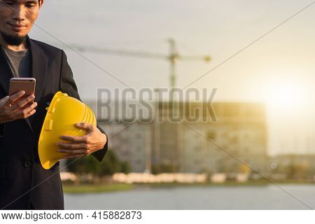 Worker Man Engineer Hold Yellow Hard Hat Use Call Phone Outdoor Site Construction Background