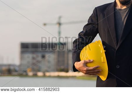 Technician Holding Yellow Hat Safety Hard Hat Sunlight Background