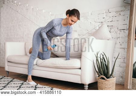 The Girl Performs Exercises For The Hands At Home. Doing Sports At Home Online. Healthy Lifestyle. D