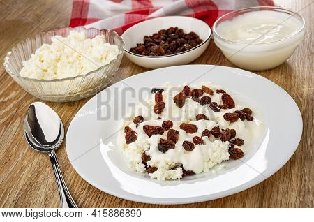 Checkered Napkin, Bowl With Raisin, Bowls With Cottage Cheese And Sour Cream, Spoon, White Plate Wit