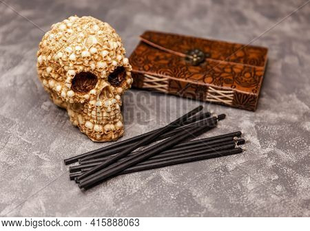 Black Candles With Skull On Witch Table. Magic Ritual. Wicca, Esoteric And Occult Background With Vi