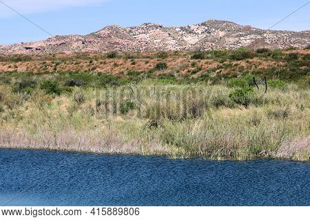 Sag Pond Caused From The San Andreas Fault Surrounded By Chaparral Plants And Arid Badlands Beyond T