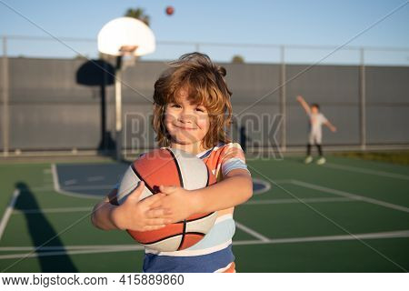 Basketball Kids Training Game. Kid Playing Basketball With Basket Ball. Child Posing With A Basketba
