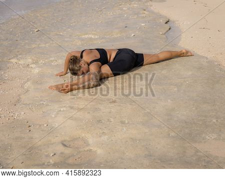 Yoga Practice. Caucasian Woman Practicing Hanumanasana, Monkey Pose Or Front Split. Forward Bend Var