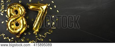 Golden Foil Balloon Number Eighty Seven. Birthday Or Anniversary Card With The Inscription 87. Black