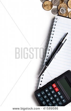 Business concept. Calculator, pen, notebook and coins.
