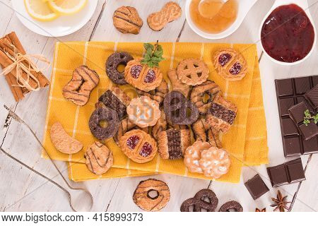 Shortcrust Pastry Biscuits With Jelly On Wooden Table.