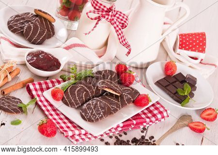 Soft Cakes With Strawberry On White Dish.