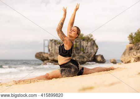 Yoga Practice. Beautiful Caucasian Woman Practicing Hanumanasana, Monkey Pose Or Front Split. Arms R