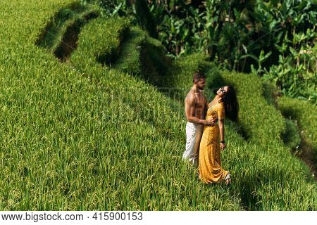 A Man And A Woman Among The Rice Terraces. A Couple In Love Travels Through Asia. Man And Woman Are