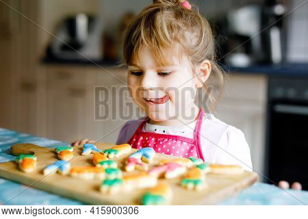 Cute Little Toddler Girl And Fresh Baked Homemade Easter Or Spring Cookies At Home Indoors. Adorable