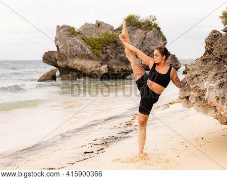 Yoga Practice. Attractive Caucasian Woman Practicing Samsahate Hanumanasana, Standing Split Pose. Ha