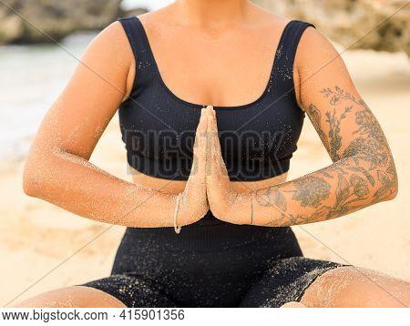 Close Up Namaste Mudra. Yoga At The Beach. Woman Sitting On Sand Practicing Yoga With Namaste Mudra.