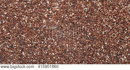 Texture Of Small Stones, Rocky Abstract Background, Grainy Surface, Gravel Pattern, Red Pebbles. Dec